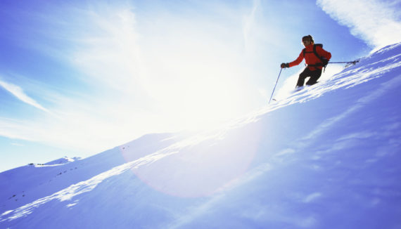 Skiing Towards the Sun --- Image by © Royalty-Free/Corbis